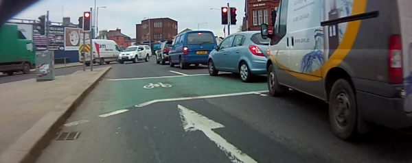 Motor vehicles blocking a cycle box at a Belfast junction
